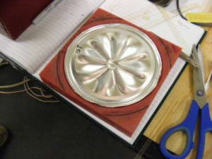 Aluminum diaphragm formed in-house using a CNC'd mold.